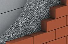 Einblasdämmung am Hohlmauerwerk
